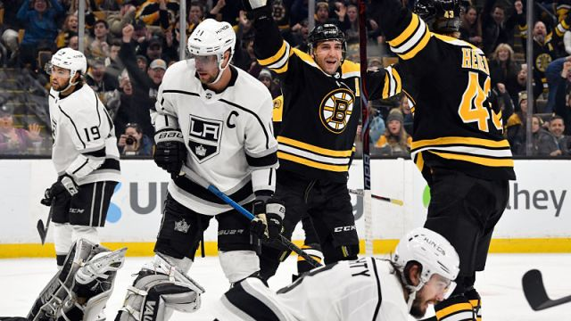 Bruins forwards Patrice Bergeron and Danton Heinen
