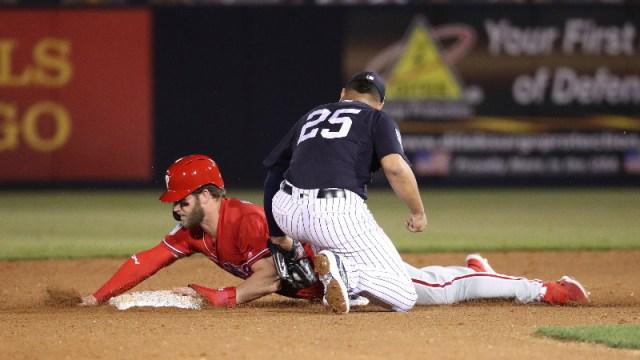 Philadelphia Phillies right fielder Bryce Harper and New York Yankees second baseman Gleyber Torres (25)