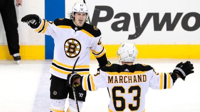 Boston Bruins' Torey Krug and Brad Marchand