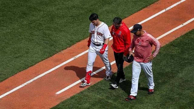 Boston Red Sox outfielder Andrew Benintendi, manger Alex Cora