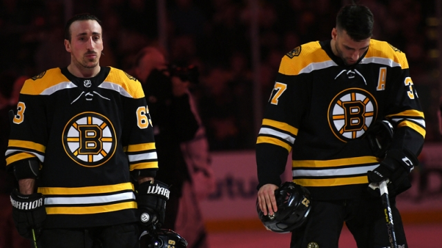 Boston Bruins' Brad Marchand and Patrice Bergeron
