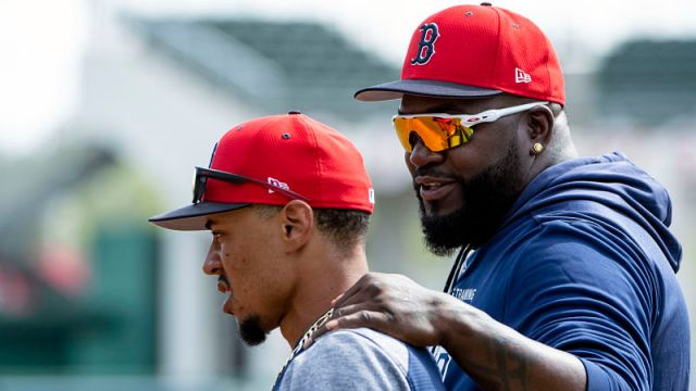 Boston Red Sox outfielder Mookie Betts and former Red Sox player David Ortiz