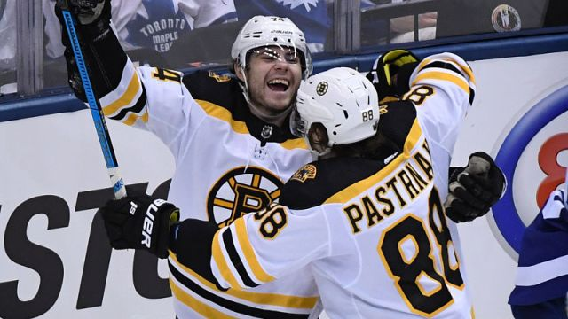 Boston Bruins forwards Jake DeBrusk, David Pastrnak