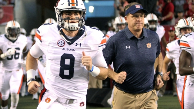 Ex-Auburn Tigers quarterback Jarrett Stidham (8) and current head coach Gus Malzahn