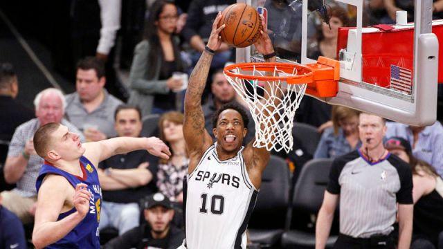 Denver Nuggets center Nikola Jokic and San Antonio Spurs guard DeMar DeRozan