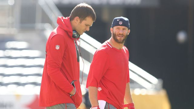 New England Patriots quarterback Tom Brady and wide receiver Julian Edelman