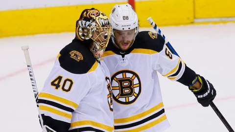 Boston Bruins' Tuukka Rask and David Pastrnak