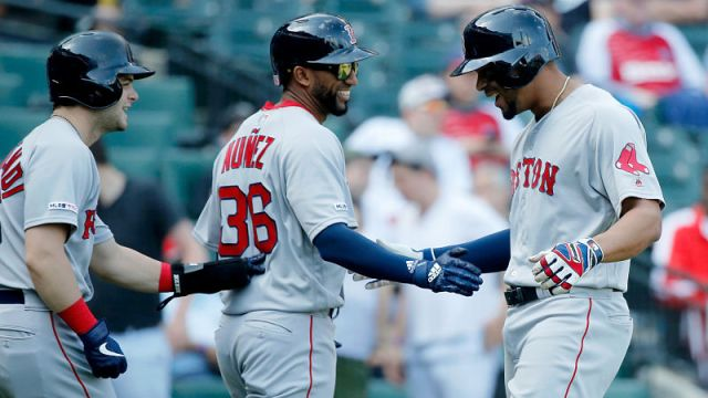 Boston Red Sox outfielder Andrew Benintendi and infielders Eduardo Nunez and Xander Bogaerts