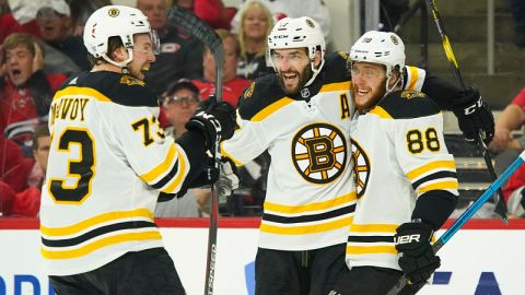 Boston Bruins defenseman Charlie McAvoy and forwards Patrice Bergeron and David Pastrnak