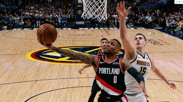 Portland Trail Blazers guard Damian Lillard and Denver Nuggets center Nikola Jokic