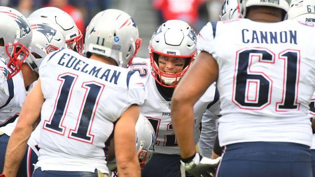 New England Patriots wide receiver Julian Edelman, quarterback Tom Brady and offensive lineman Marcus Cannon
