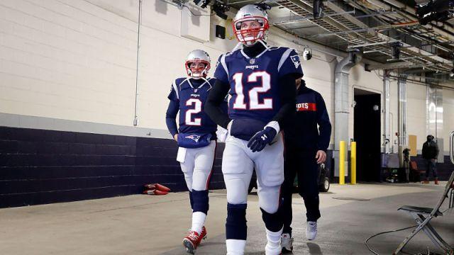 New England Patriots quarterbacks Brian Hoyer and Tom Brady