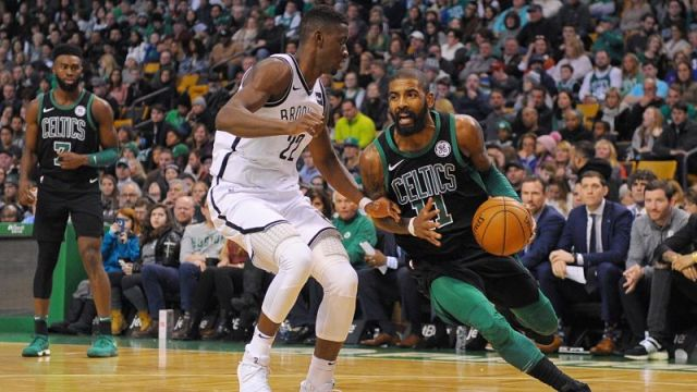 Brooklyn Nets guards Caris LeVert and Kyrie Irving