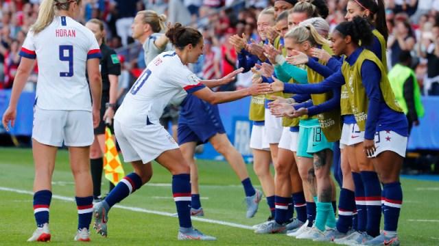 United States forward Carli Lloyd (10) and teammates