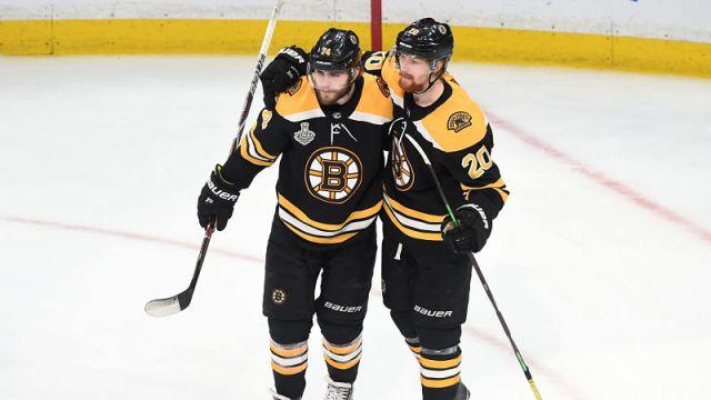 Boston Bruins left wing Jake DeBrusk and center Joakim Nordstrom