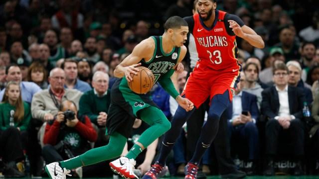 Boston Celtics forward Jayson Tatum (0) and ex-New Orleans Pelicans center Anthony Davis (23)