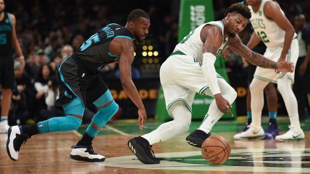 Charlotte Hornets guard Kemba Walker and Boston Celtics guard Marcus Smart