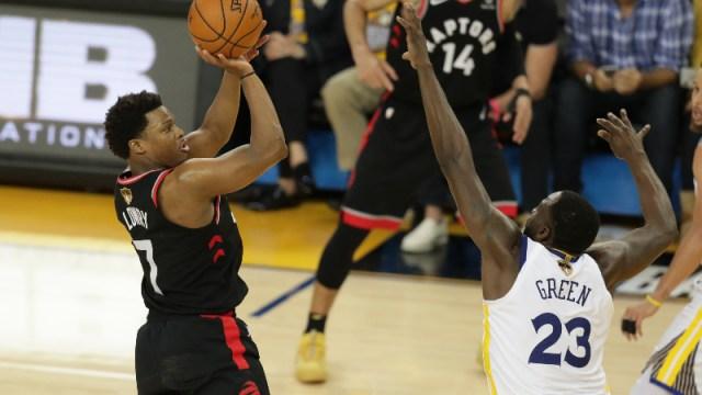 Toronto Raptors guard Kyle Lowry (7) and Golden State Warriors forward Draymond Green (23)