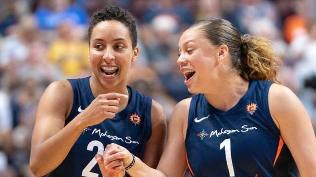 Connecticut Sun players Layshia Clarendon, Rachel Banham (right)