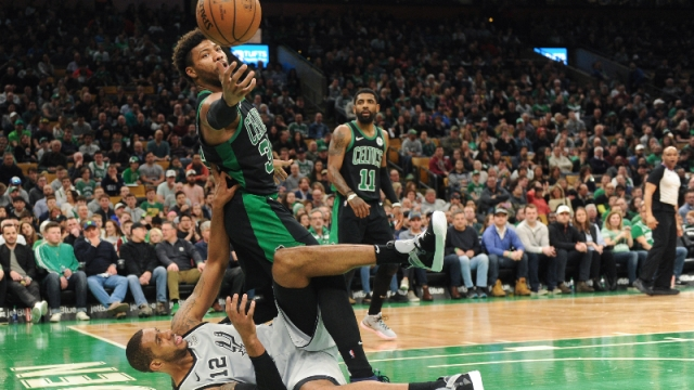 Boston Celtics guard Marcus Smart (36) and San Antonio Spurs forward Rudy Gay (22)