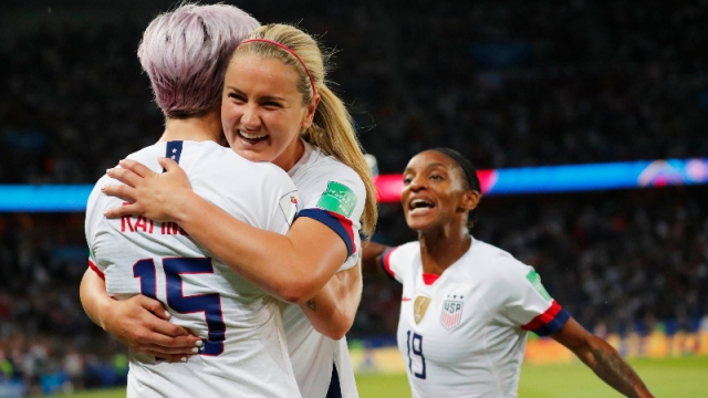 United States forward Megan Rapinoe (15), midfielder Lindsey Horan (9) and defender Crystal Dunn (19)