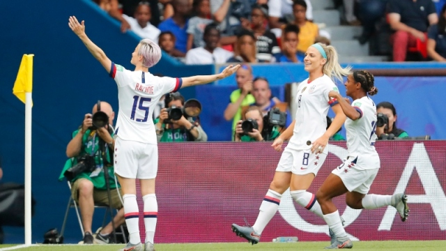 ; United States forward Megan Rapinoe (15), midfielder Julie Ertz and defender Crystal Dunn (19)