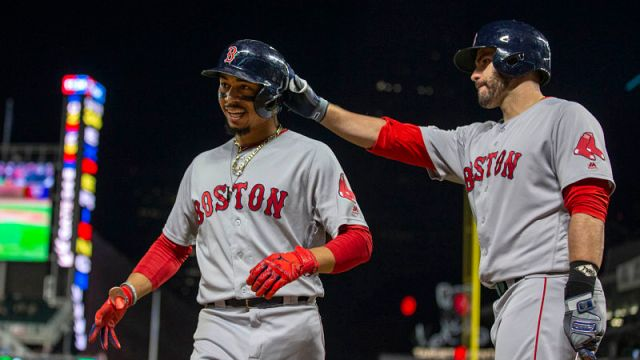Boston Red Sox outfielders Mookie Betts, J.D. Martinez