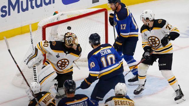 Boston Bruins goalie Tuukka Rask, defenseman Charlie McAvoy