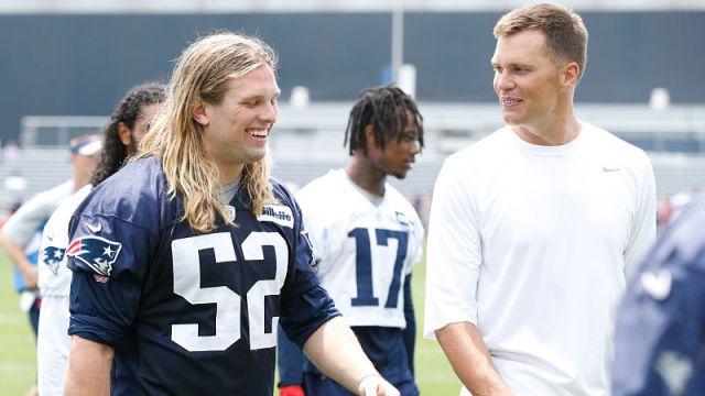 New England Patriots defensive lineman Chase Winovich and quarterback Tom Brady