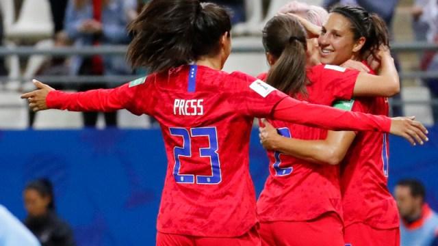 United States forward Carli Lloyd (right) and teammates Christen Press (23) and Mallory Pugh (2)