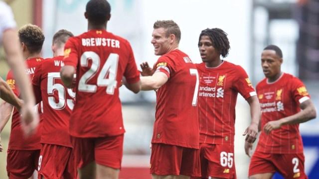 Liverpool striker Rhian Brewster (24), James Milner (7) and teammates