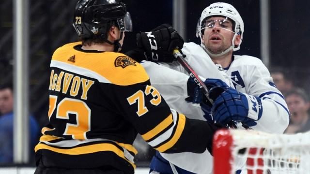 Boston Bruins defenseman Charlie McAvoy (73) and Toronto Maple Leafs center John Tavares (91)