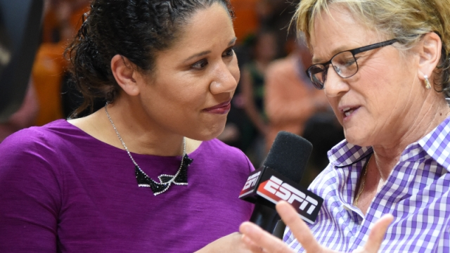 Boston Celtics assistant coach Kara Lawson (left) and Tennessee Lady Volunteers head coach Hooly Warlick