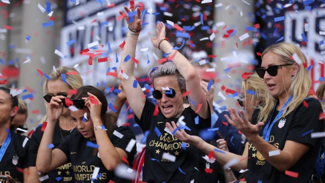 United States women's national soccer team forward Megan Rapinoe and teammates