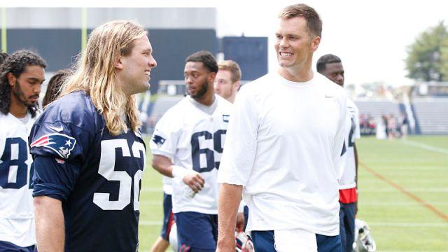 New England Patriots defensive lineman Chase Winovich and Tampa Bay Buccaneers quarterback Tom Brady