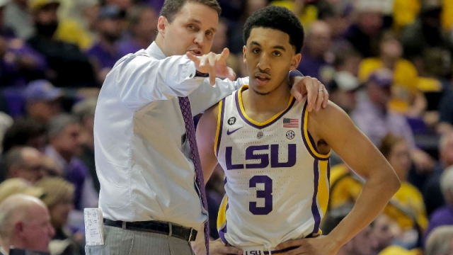 Former LSU Tigers guard Tremont Waters and head coach Will Wade