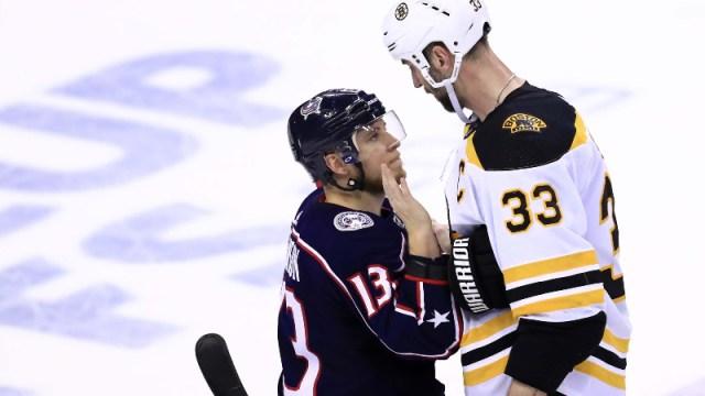 Boston Bruins defenseman Zdeno Chara (33) and Columbus Blue Jackets right wing Cam Atkinson (13)