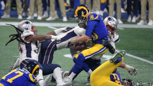 New England Patriots defensive end Adrian Clayborn (94), outside linebacker Dont'a Hightower (54) and middle linebacker Kyle Van Noy (53) and Los Angeles Rams quarterback Jared Goff (16)