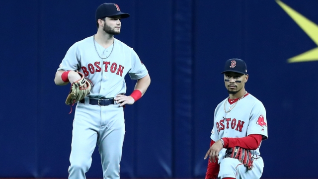 Red Sox outfielders Andrew Benintendi, Mookie Betts
