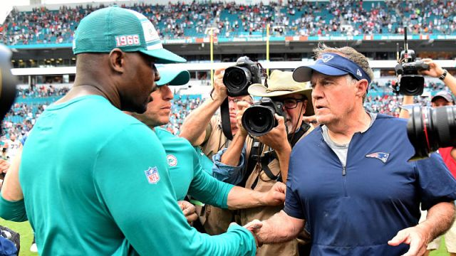 Miami Dolphins head coach Brian Flores and New England Patriots head coach Bill Belichick