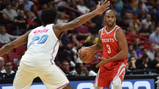 Houston Rockets guard Chris Paul (3) and Miami Heat forward Justice Winslow