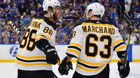 Boston Bruins right wing David Pastrnak (88) and left wing Brad Marchand (63)