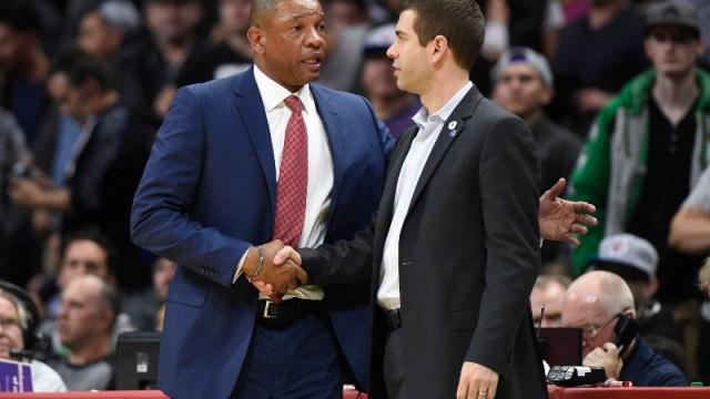 Los Angeles Clippers head coach Doc Rivers (left) and Boston Celtics head coach Brad Stevens