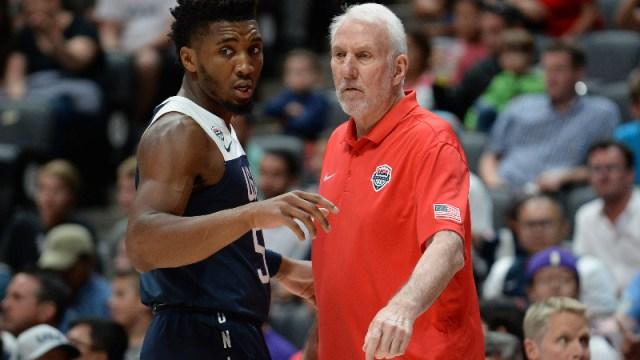 USA head coach Gregg Popovich and guard Donovan Mitchell