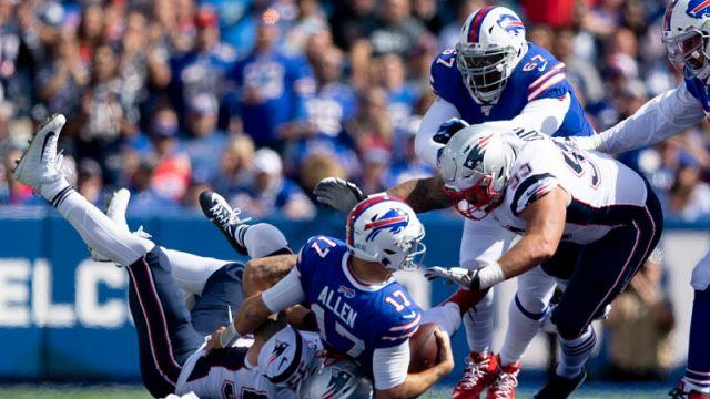 New England Patriots linebacker John Simon and Buffalo Bills quarterback Josh Allen
