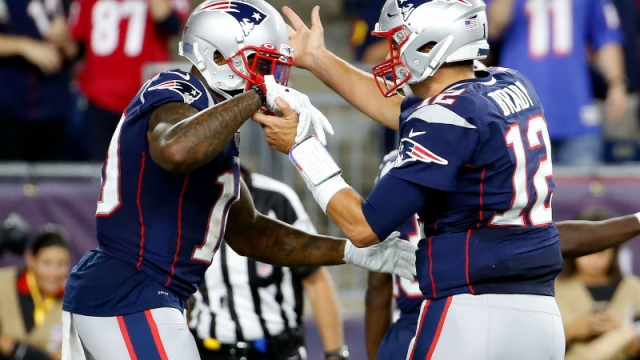 New England Patriots quarterback Tom Brady (12) and wide receiver Josh Gordon (10)