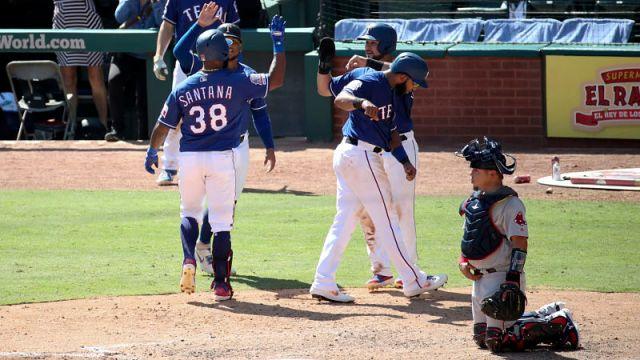 Texas Rangers center fielder Danny Santana and Boston Red Sox catcher Juan Centeno