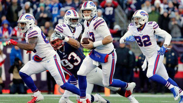 New England Patriots defensive lineman Lawrence Guy and Buffalo Bills quarterback Josh Allen