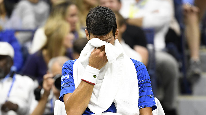 Novak Djokovic Booed At Us Open After Shoulder Injury Forces Him To Retire Nesn Com