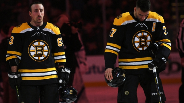 Boston Bruins left wing Brad Marchand (63) and center Patrice Bergeron (37)